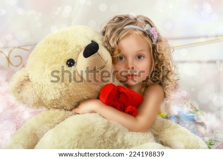Portrait of a charming little girl hugging Teddy bear - stock photo