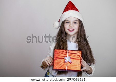 Portrait of a charming little girl on christmas, isolated in white background - stock photo