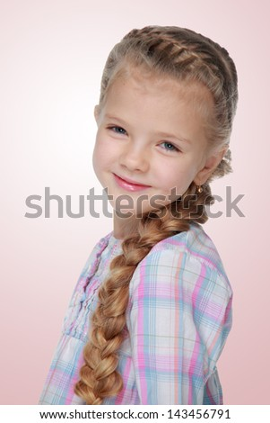 Portrait of a charming little girl with beautiful long braid