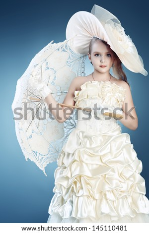 Portrait of a charming little lady in a beautiful elegant dress. - stock photo