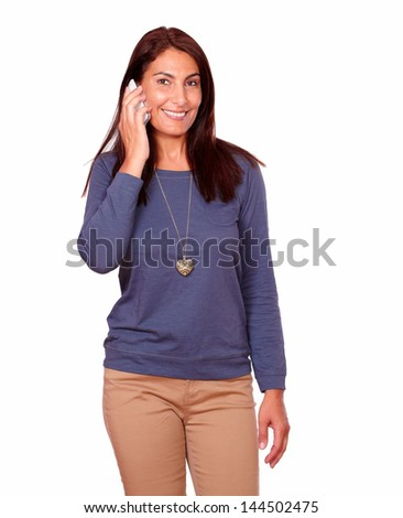 Portrait of a charming senior woman speaking on cellphone while is looking at you on isolated background - stock photo