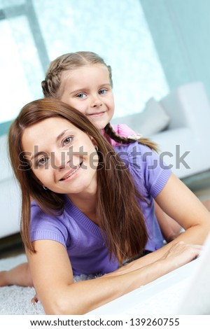 Portrait of a charming woman and her daughter