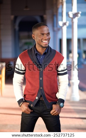 Portrait of a charming young african american man smiling outdoors - stock photo