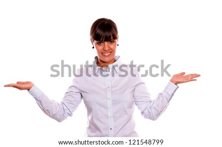 Portrait of a charming young business woman holding out her palms and showing you copyspace on isolated background - stock photo