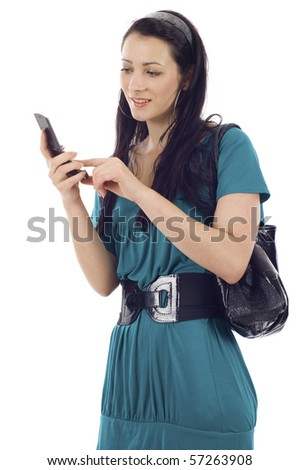 Portrait of a charming young fashion lady text messaging on cellphone isolated over white background - stock photo