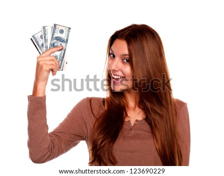 Portrait of a charming young female with cash money with long brow hair against white background - stock photo