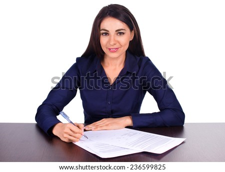 Portrait of a cheerful business woman sitting on her desk and sign up contract isolated over white background - stock photo