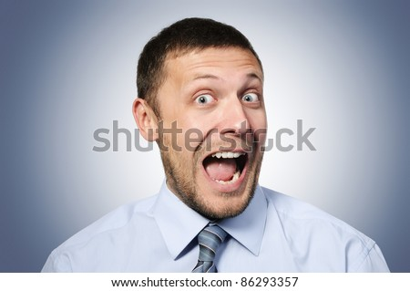 Portrait of a cheerful businessman funny expression - stock photo
