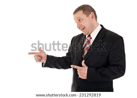 Portrait of a cheerful businessman pointing finger forward.Studio Shot.Isolated on White.