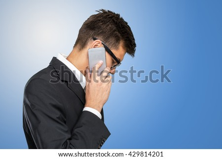 Portrait of a cheerful businessman talking on the phone - stock photo