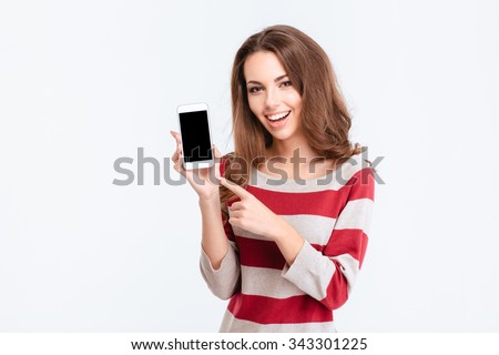 Portrait of a cheerful cute woman showing blank smartphone screen isolated on a white background - stock photo
