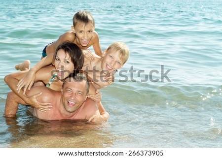 Portrait of a cheerful family have a great time - stock photo