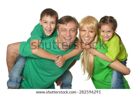 Portrait of a cheerful family of four  on a white background - stock photo