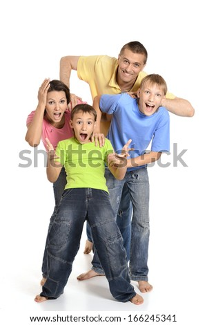 Portrait of a cheerful family of four people having fun on a white background