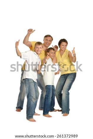 portrait of a cheerful family of four people on white background