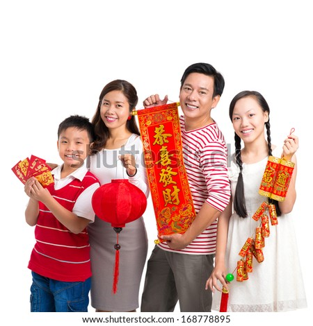 Portrait of a cheerful family with Tet ornaments posing at camera over white  - stock photo