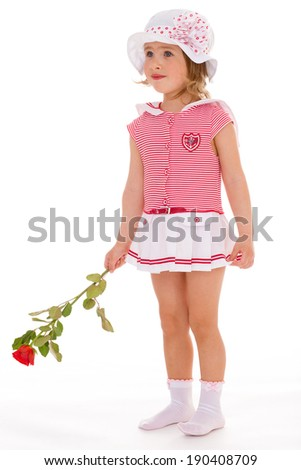 Portrait of a cheerful girl in a pink dress on a white background - stock photo