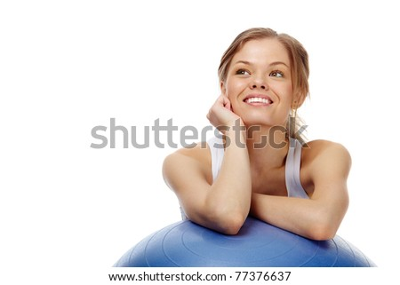 Portrait of a cheerful girl looking up - stock photo