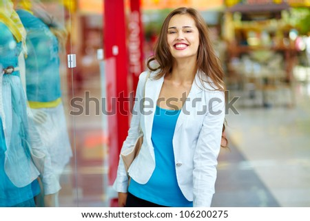 Portrait of a cheerful lady having a good time in the shopping mall