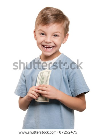 Portrait of a cheerful little boy holding a dollars over white background - stock photo