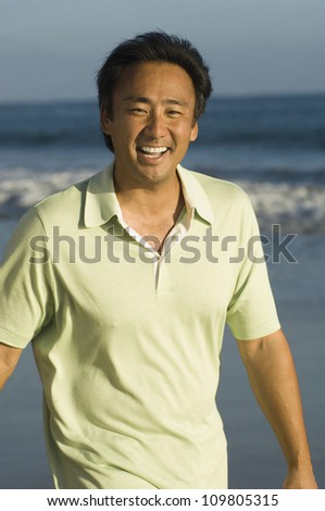 Portrait of a cheerful man on the beach