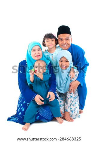 Portrait of a cheerful muslim family - stock photo