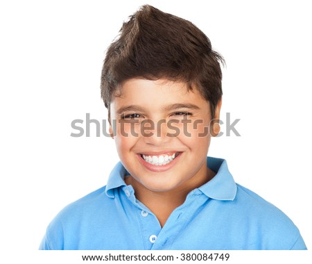 Portrait of a cheerful smiling boy isolated on white background, teenage model posing in the studio, happy facial expression, perfect toothy smile - stock photo