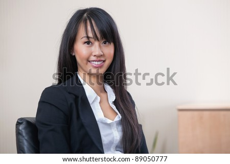 Portrait of a cheerful young businesswoman smiling - stock photo