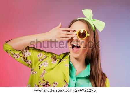 Portrait of a cheerful young girl in bright casual clothes smiling at the camera with beautiful smile.  Colorful background - stock photo