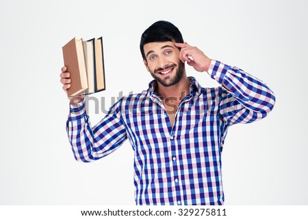 Portrait of a cheerful young man holding books isolated on a white background - stock photo