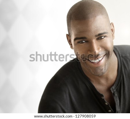Portrait of a  cheerful young smiling casual man against white modern background with copy space - stock photo