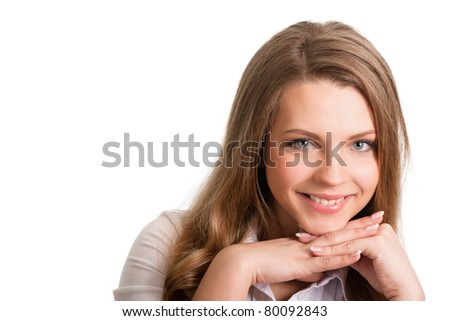 Portrait of a cheerful young woman against white background - stock photo