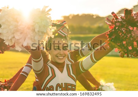 Portrait of a cheerleader in action - stock photo
