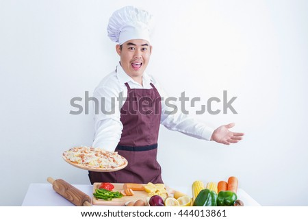 Portrait of a chef holding a pizza isolated on white background