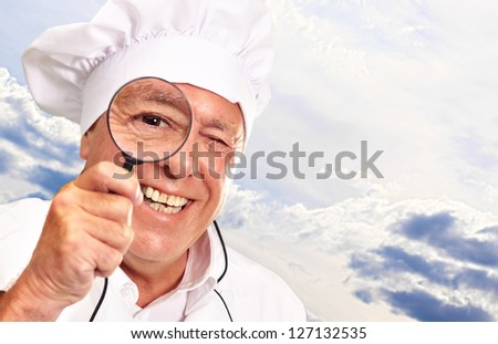 Portrait Of A Chef Holding Magnifying Glass, Outdoor - stock photo