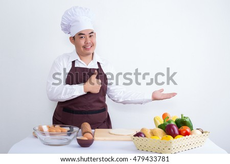Portrait of a chef with vegetable and fruit  on white room