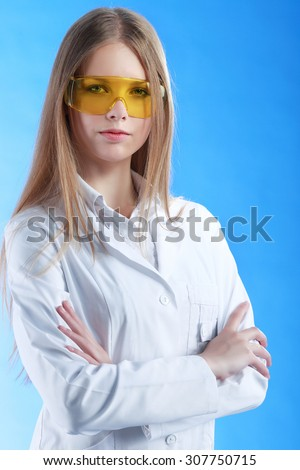 Portrait of a chemist with arms crossed  - stock photo