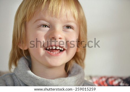 Portrait of a child aged three years old laughing