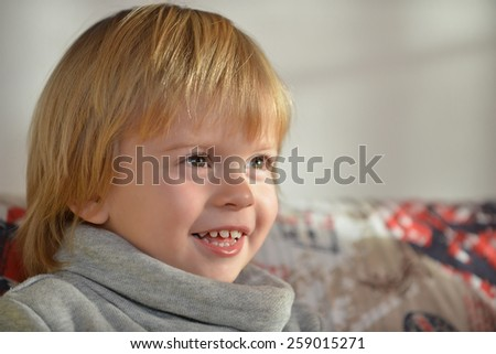 Portrait of a child aged three years old smiling - stock photo