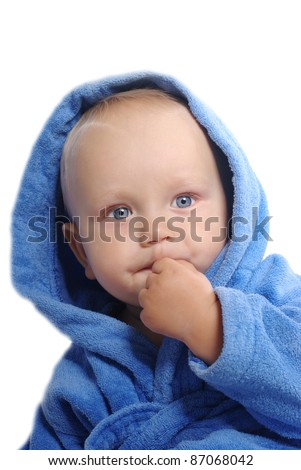 Portrait of a child in blue bathrobe, isolated over white - stock photo