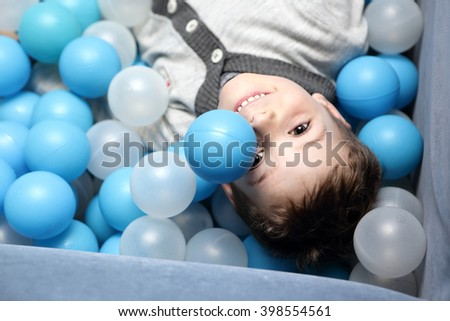 Portrait of a child on the balls - stock photo