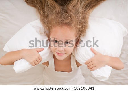 portrait of a child on the bed with her hair