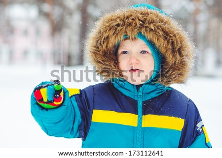 Portrait of a child points his finger to the side. - stock photo
