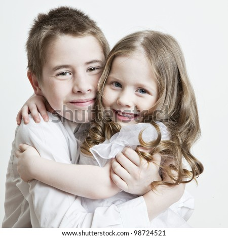 Portrait of a child, the love of brother and sister in his arms on a white background - stock photo