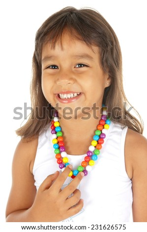 Portrait of a child using colors necklace - stock photo