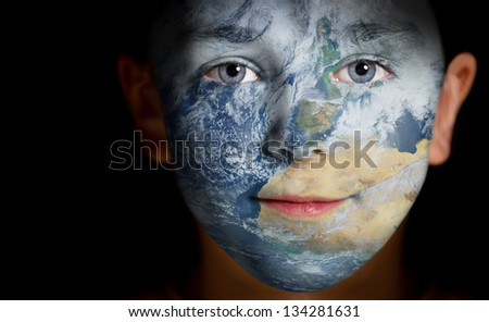 Portrait of a child with a painted Africa. Elements of this image furnished by NASA