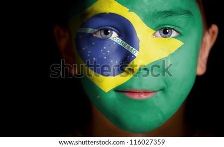 Portrait of a child with a painted flag, closeup - stock photo