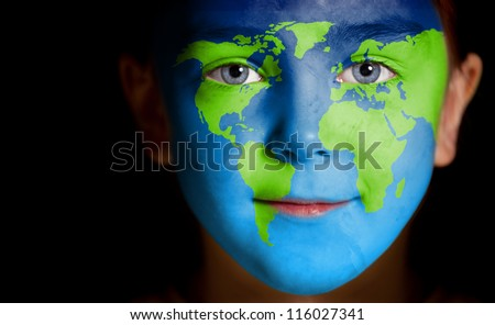 Portrait of a child with a painted world map, closeup - stock photo