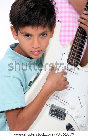 portrait of a child with guitar - stock photo