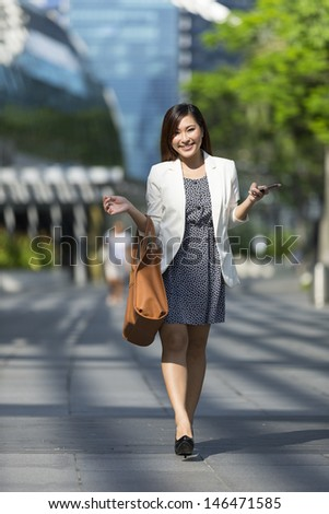Portrait of a Chinese Businesswoman with bag - stock photo